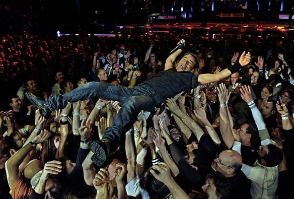 The Boss in the hands of his fans, literally and figuratively
