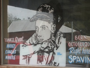 Store front window in Spavinaw, Oklahoma. The only visible indicator that mantle was born there