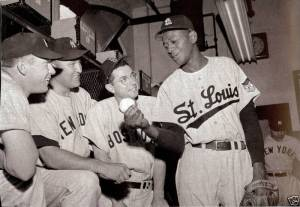 Mickey Mantle and Vic Dimaggio listen to Satchel Paige school them on throwing the stinky cheese