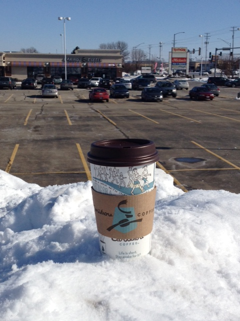 Caribou Coffee cup high atop 'Mount Dekalb' with Caribou location in background