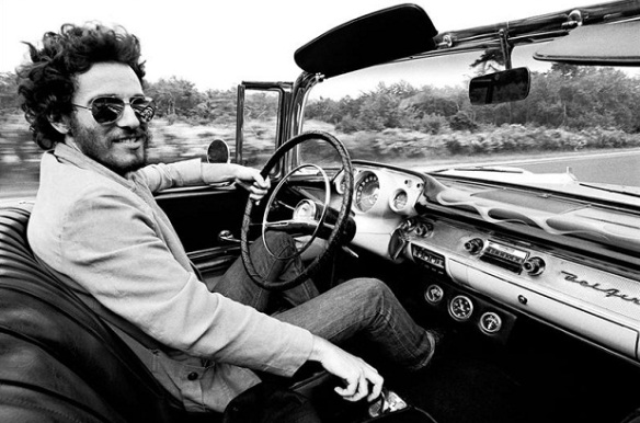 Springsteen driving a Chevy Bel Aire