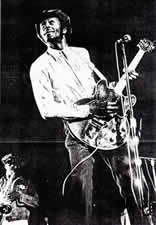 Chuck Berry with Clarence Clemons in background, from 4-28-73 concert, University of Maryland