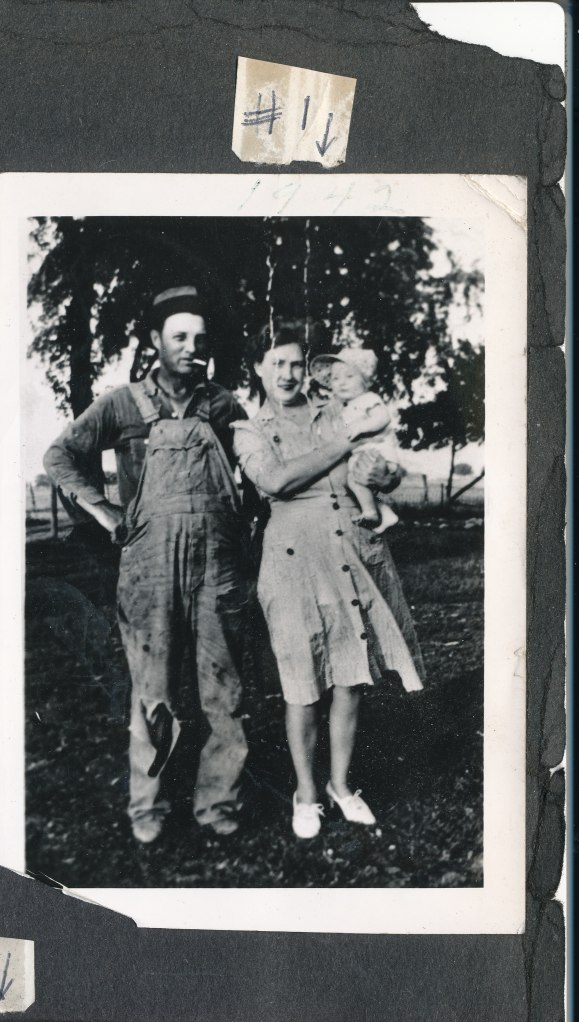 Robert Lee being held by Kenneth and Eva Hilligoss