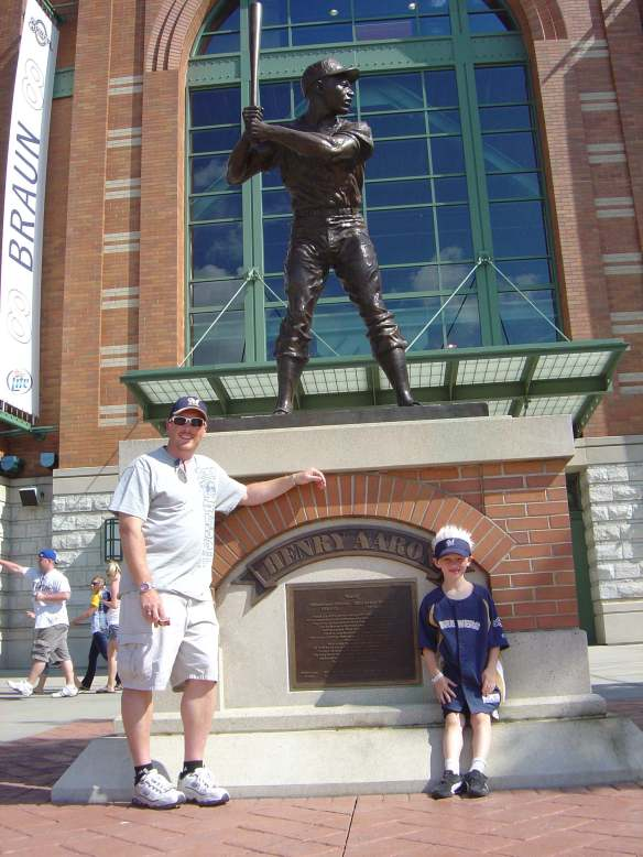 Ryan and Graham in front of the Henry Aaron statue outside of Miller Park, Milwaukee, Wi